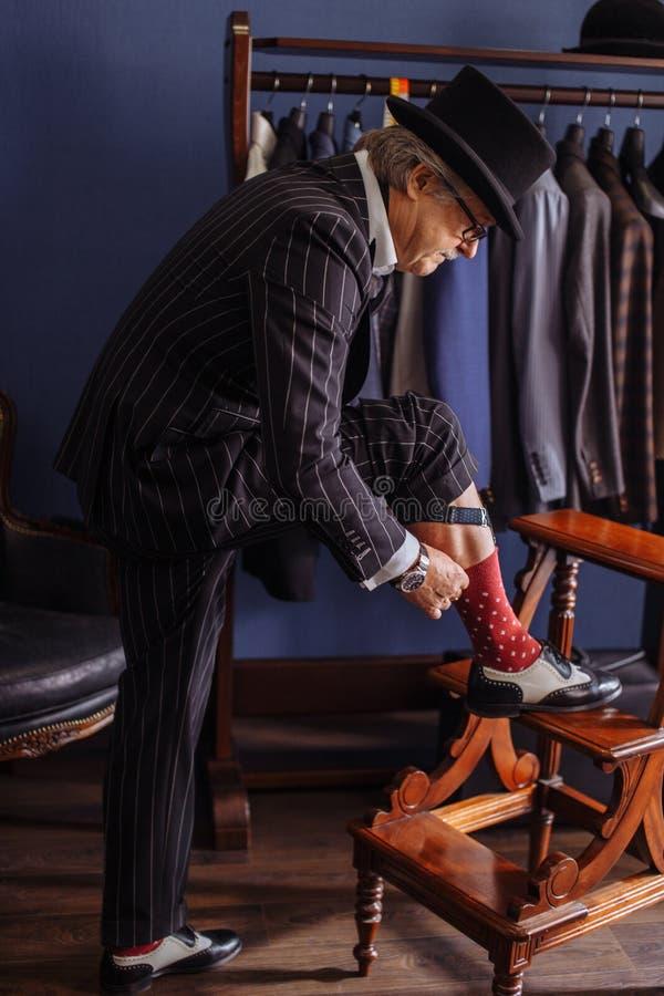 Confident retro style fashion man visiting tailor`s workshop stock photos