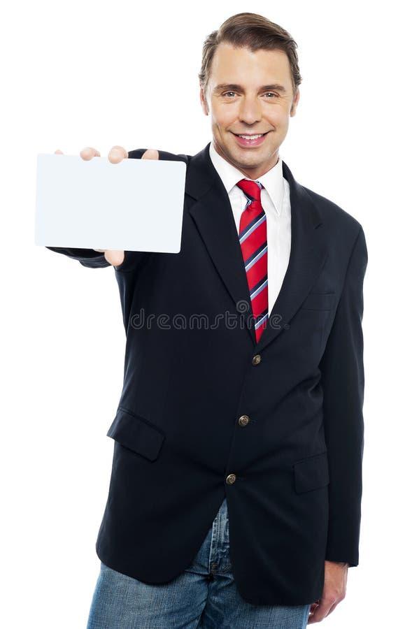 Confident sales representative presenting placard