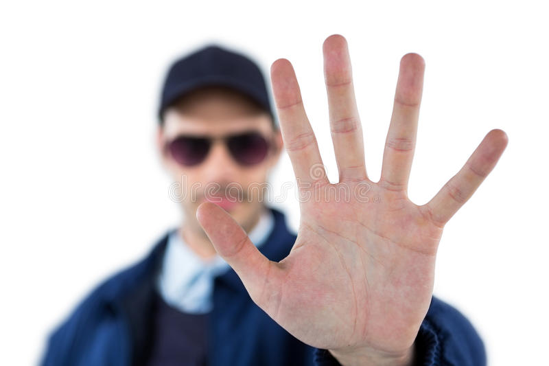 Confident security officer making stop gesture stock photos
