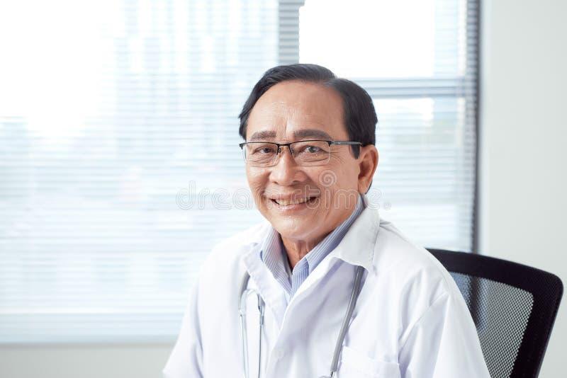 Confident senior citizen as competent doctor.  stock images