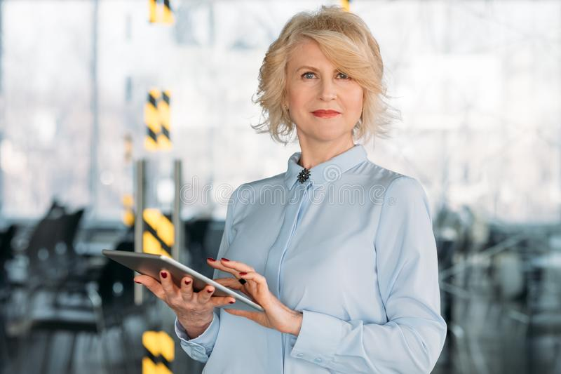 Confident senior lady work corporate ceo tablet stock images