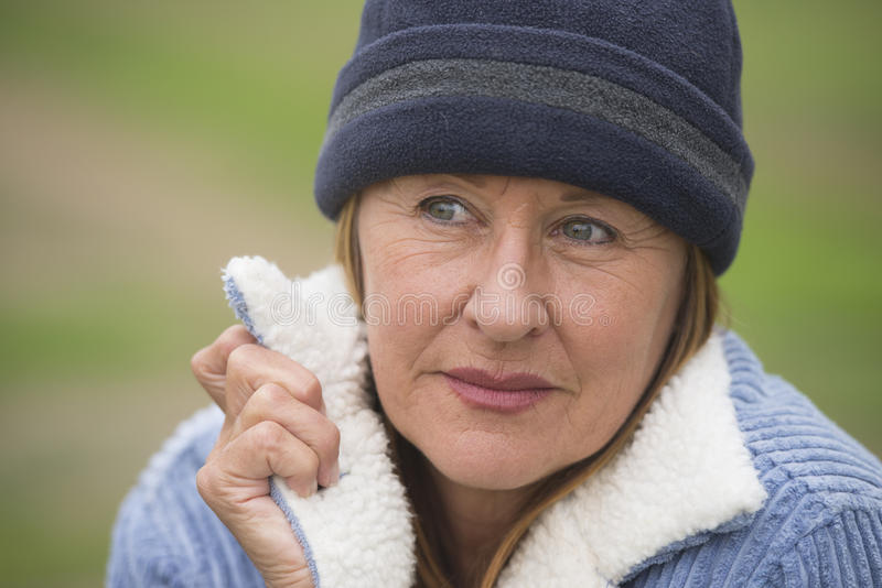 Confident senior woman warm winter jacket stock photography
