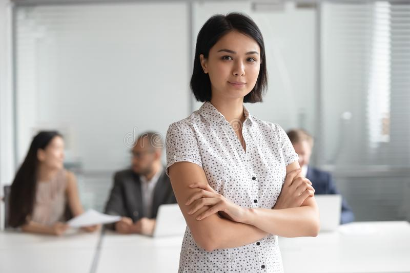 Confident serious pleasant korean female executive manager portrait. royalty free stock photography