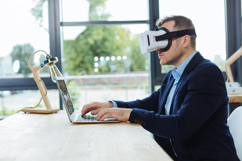 Confident smart businessman using 3d technology royalty free stock photography