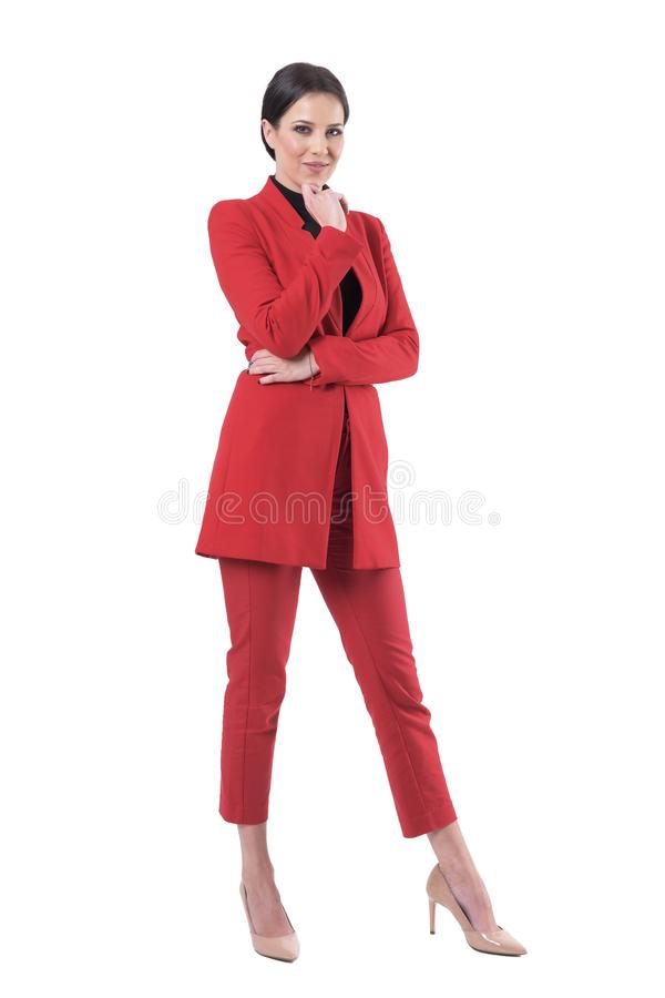 Confident smart elegant business woman ceo in red suit posing. royalty free stock photography
