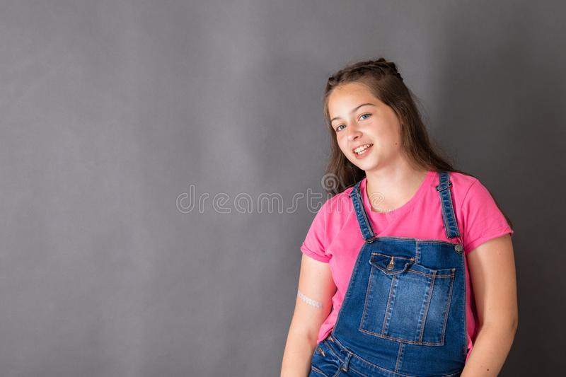 Confident smiling girl student on gray background stock photos