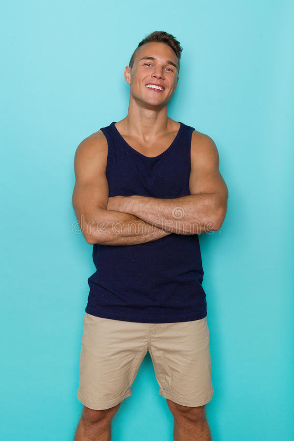 Confident Smiling Man In Blue Tank Top stock photo