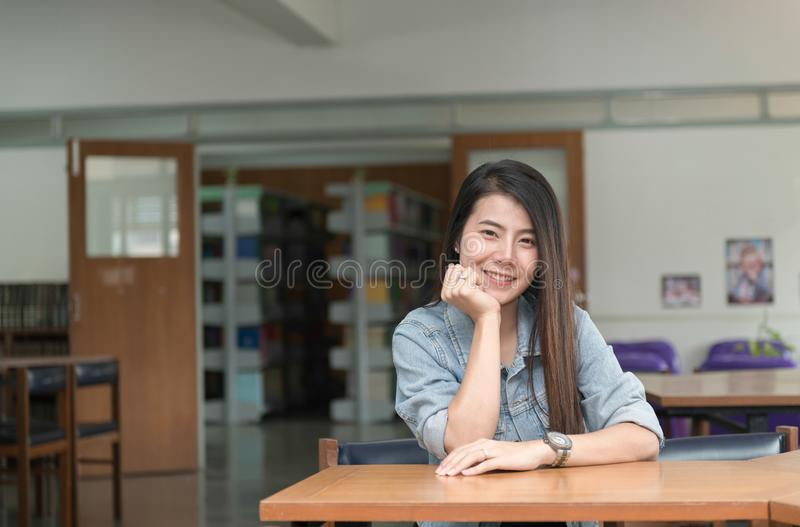 Confident smiling student asian girl in the library royalty free stock image