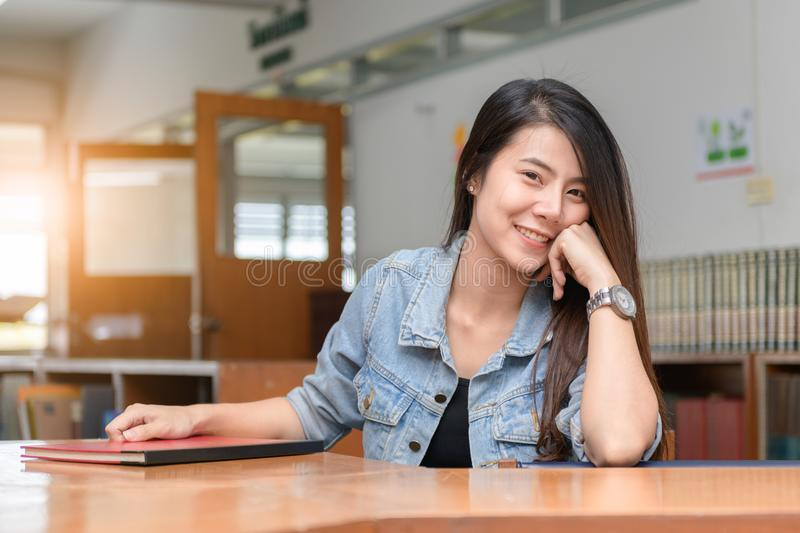 Confident smiling student asian girl in the library stock photos