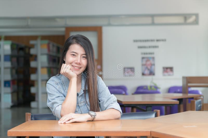 Confident smiling student asian girl in the library university stock images