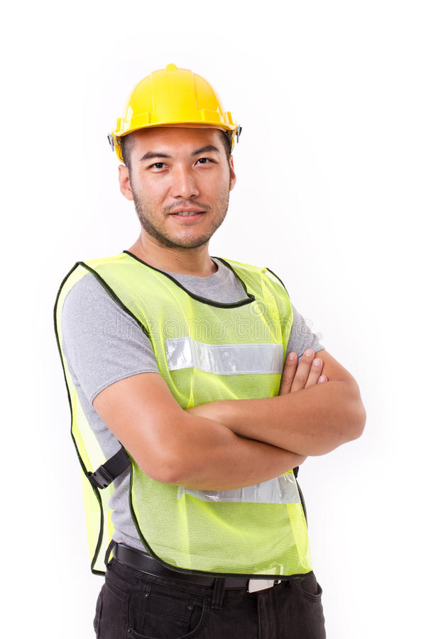 Confident, strong construction worker crossing his arms stock photo