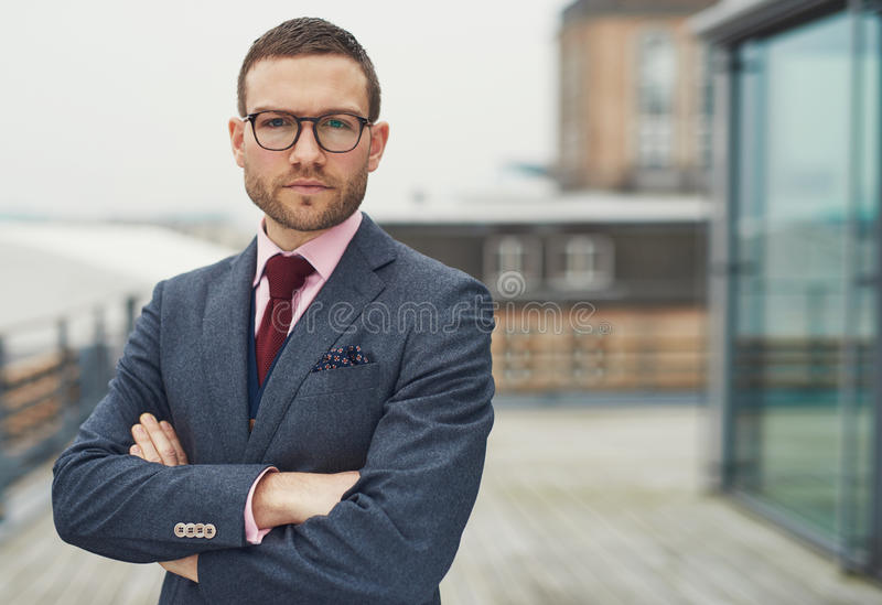 Confident stylish businessman on a balcony royalty free stock image