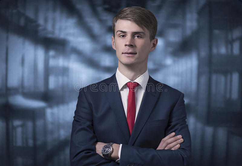Confident stylish young man in a business suit stock image