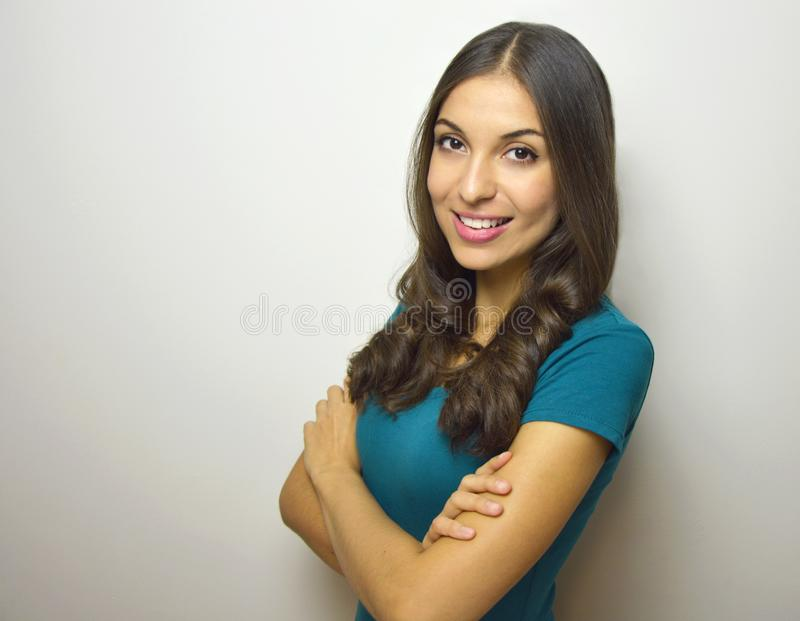 Confident and successful. Beautiful young woman in smart casual wear keeping arms crossed and looking at camera with smile while royalty free stock photography