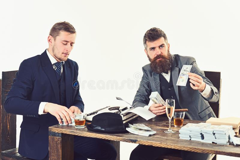 Confident and successful. Business partners writing financial report. Busy men planning company budget. Businessmen royalty free stock photography