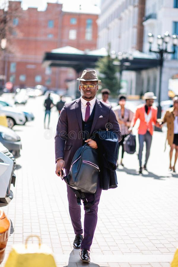 Confident successful businessman strolling on the street royalty free stock image