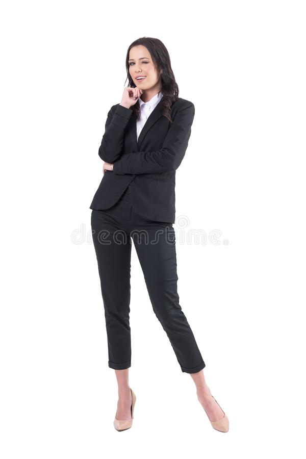 Confident successful elegant business lady winking at camera. royalty free stock image