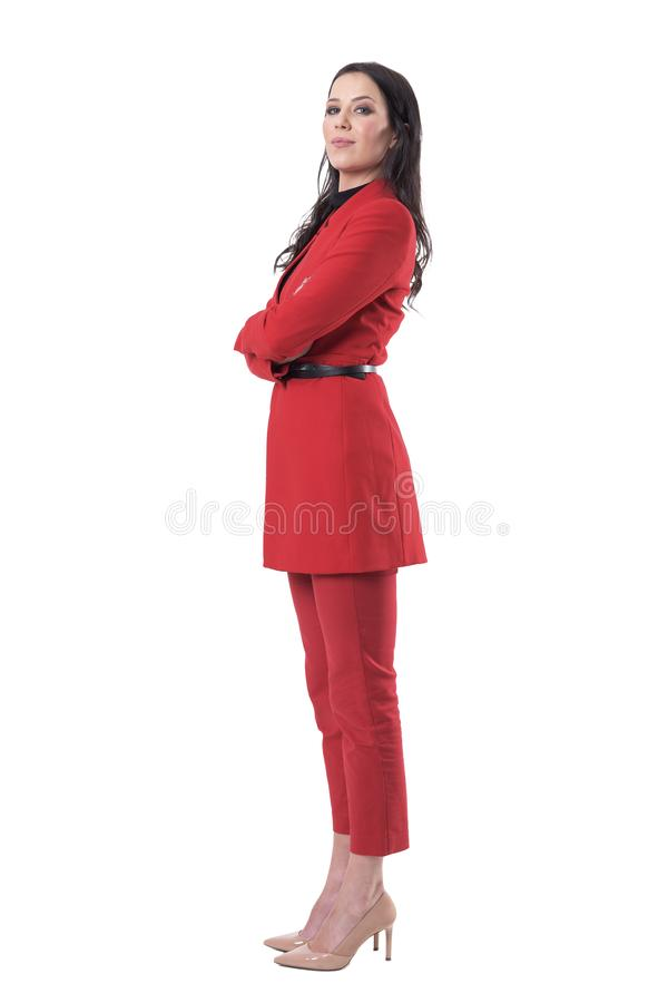 Confident successful female business director in red suit standing with crossed arms stock images