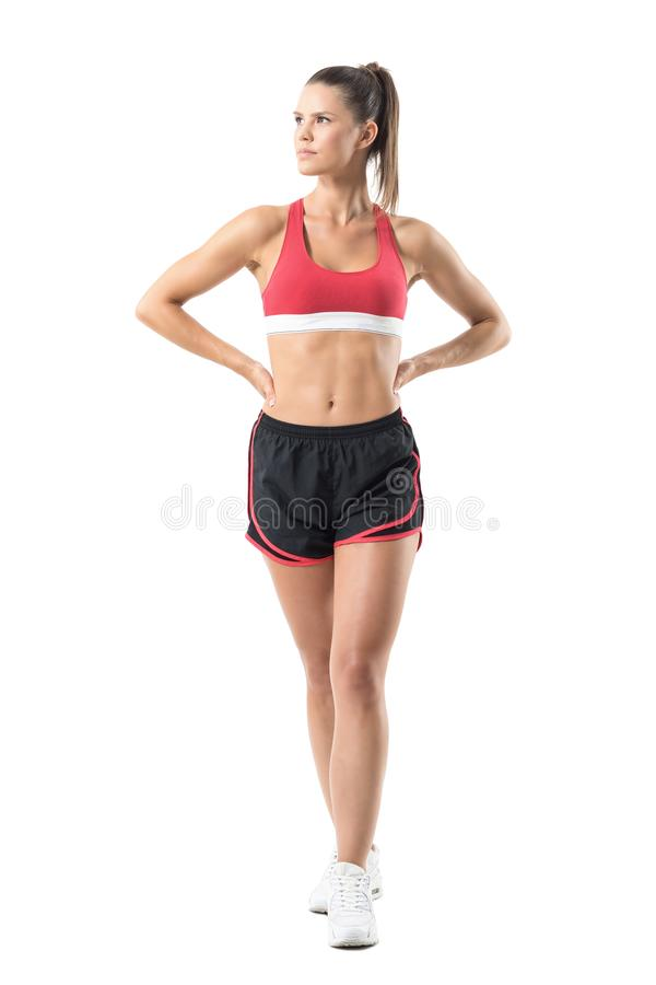 Confident successful fitness female model posing and looking up. royalty free stock photography