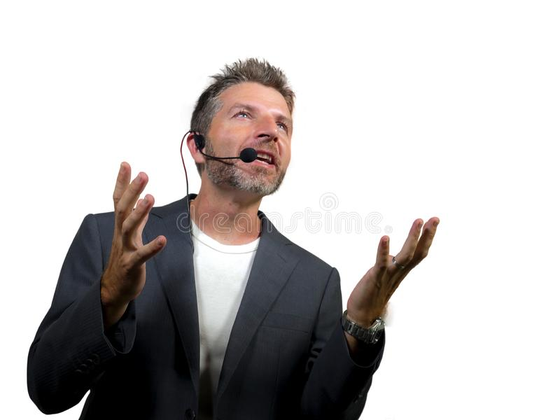 Confident successful man with headset speaking at corporate business coaching and training auditorium conference room talking. Young attractive and confident stock photos