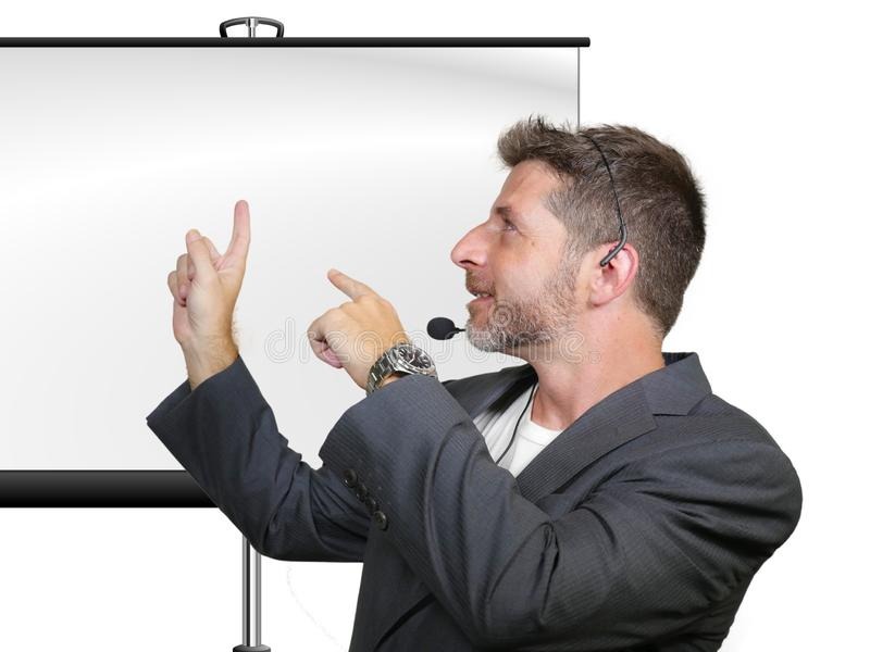 Confident successful man with headset speaking at corporate business coaching and training auditorium conference room talking. Young attractive and confident stock images