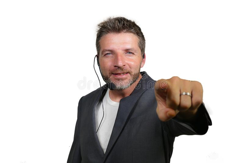 Confident successful man with headset speaking at corporate business coaching and training auditorium conference room talking. Young attractive and confident stock image