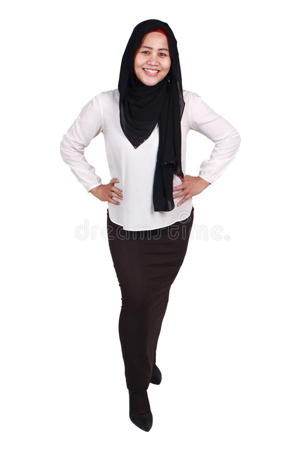 Confident Successful Muslim Lady Smiling Friendly. Successfull happy Asian muslim woman wearing hijab smiling friendly with hands on hips, confident strong stock photography