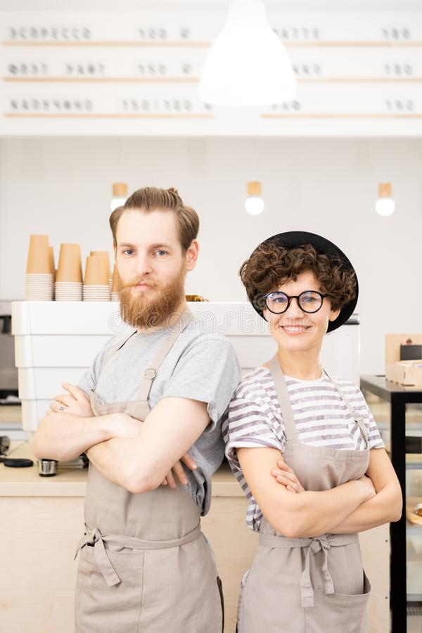 Confident team of young baristas royalty free stock images