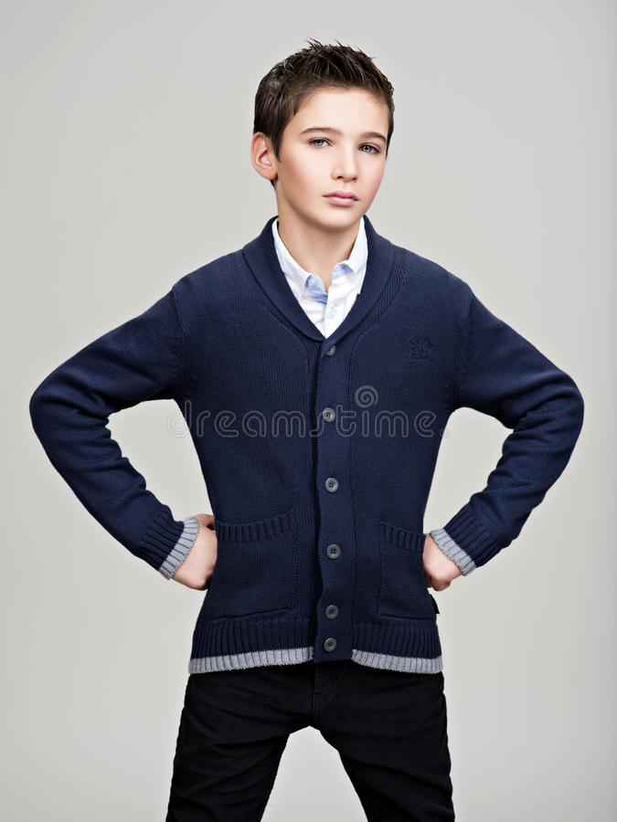 Confident teenage boy posing at studio royalty free stock image