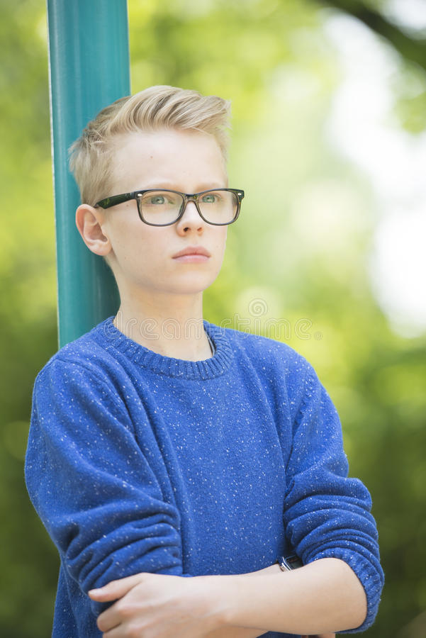 Confident teenager boy with glasses portrait stock photos