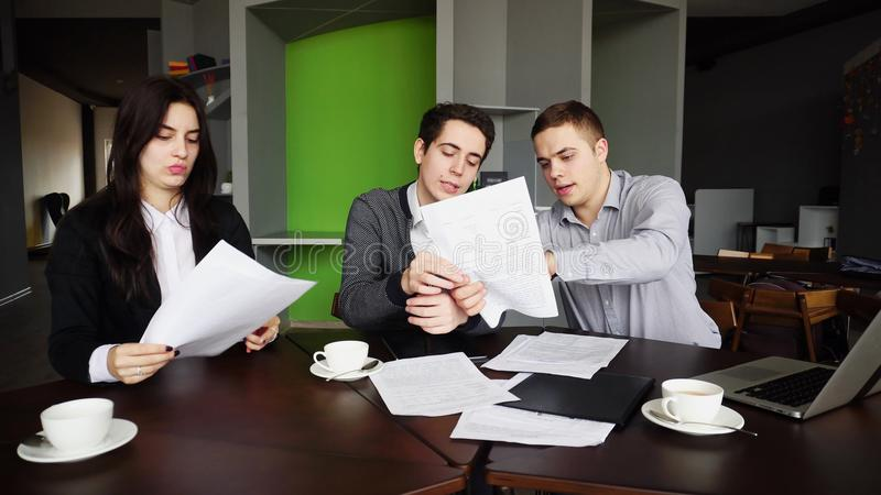 Three successful managers, two guys and girl prepare opinion on royalty free stock image