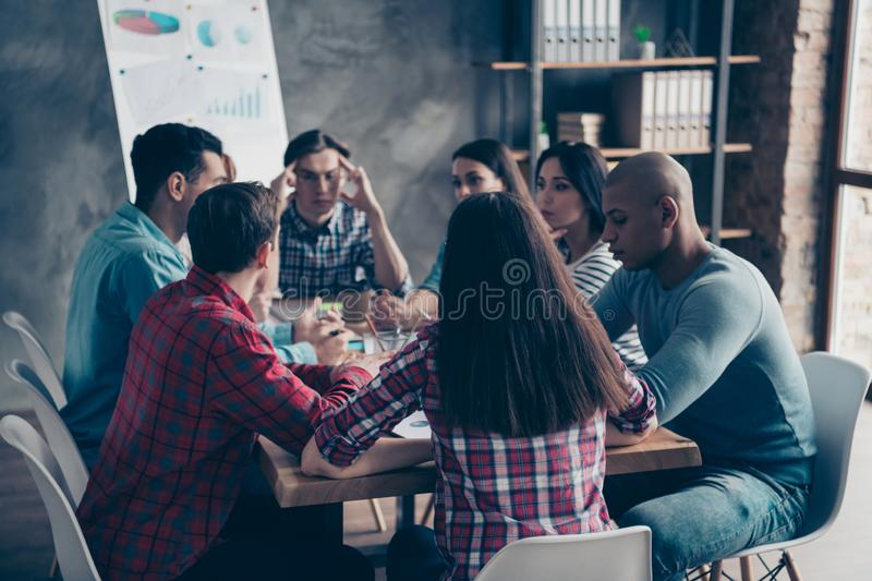 Confident thoughtful leaders leadership thinking about successful strategy having conversation gather together at table stock photos