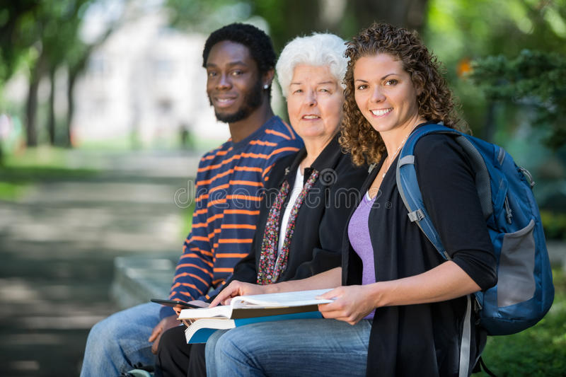 Confident University Students Sitting On Campus royalty free stock photo
