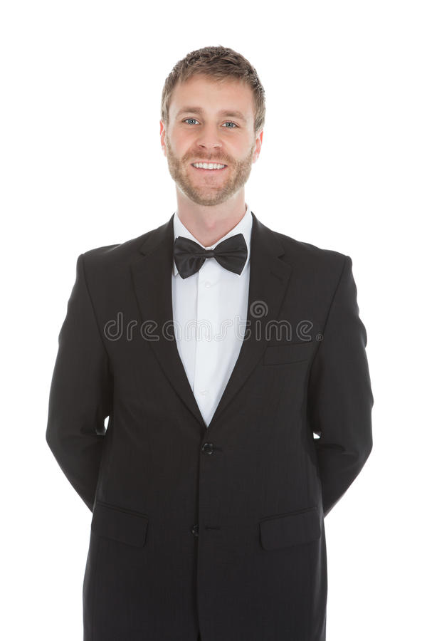 Confident waiter standing hands behind back royalty free stock image
