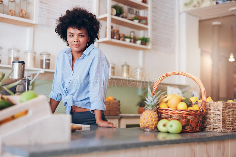 Confident woman juice bar owner royalty free stock photo