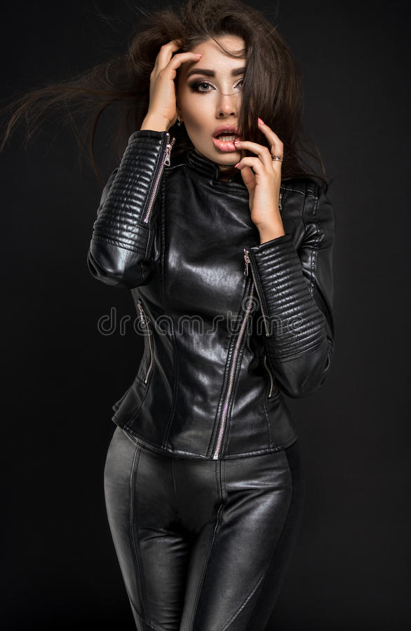 Confident woman portrait in black costume stock photos