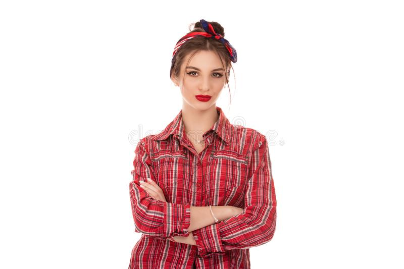 Confident woman. Portrait of a young serious woman posing with hands crossed stock image