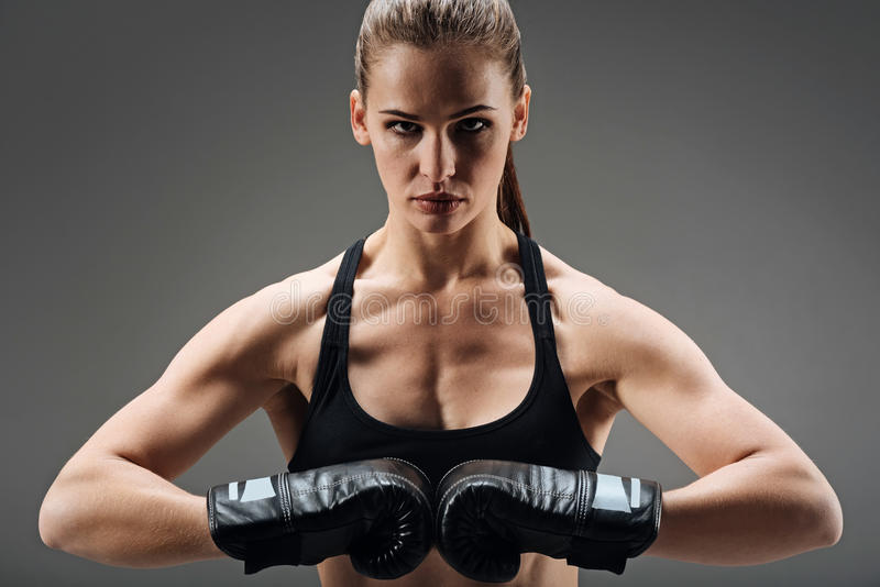 Confident woman posing with boxing gloves royalty free stock photos