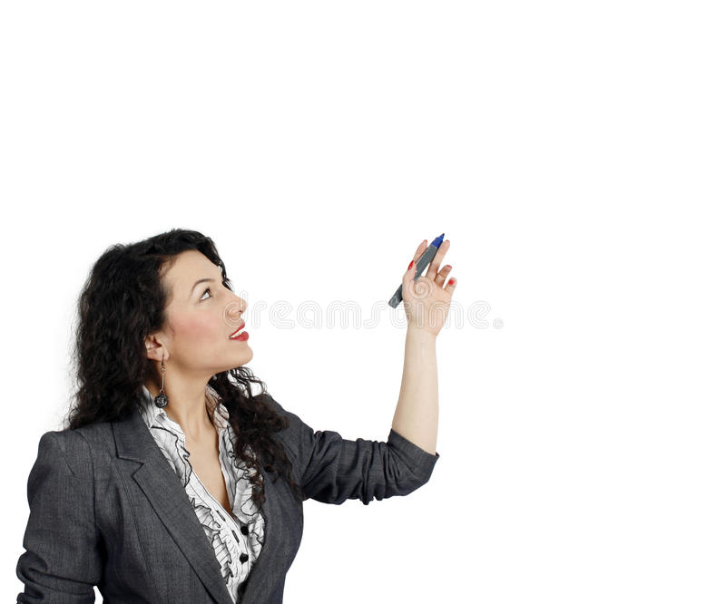 Confident woman presenting information. On a whiteboard royalty free stock photo