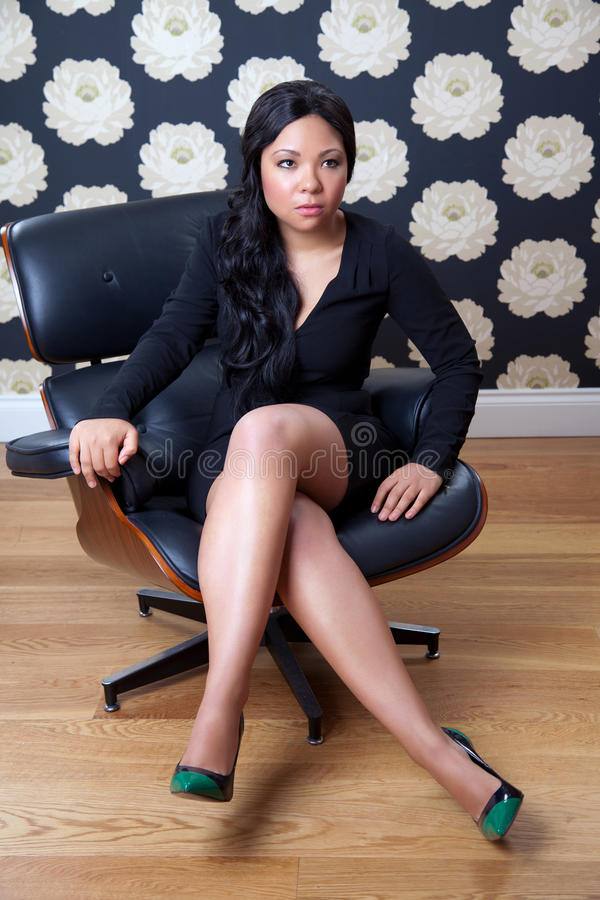 Download Confident Woman Sitting On A Leather Chair Stock Image - Image: 27423439