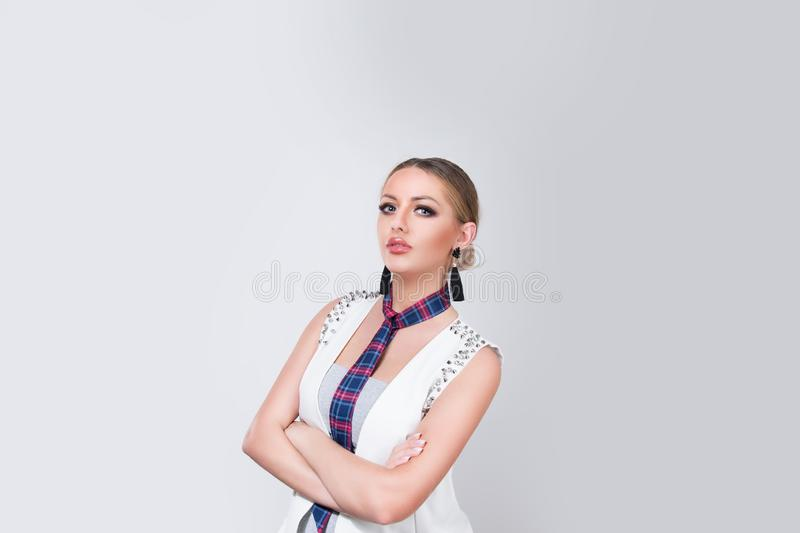 Confident woman standing with arms crossed royalty free stock images