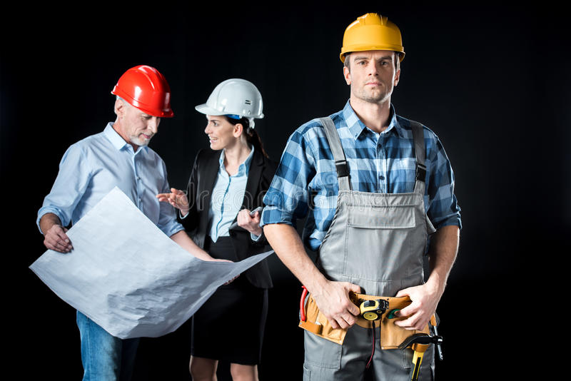 Confident worker and architects royalty free stock photography