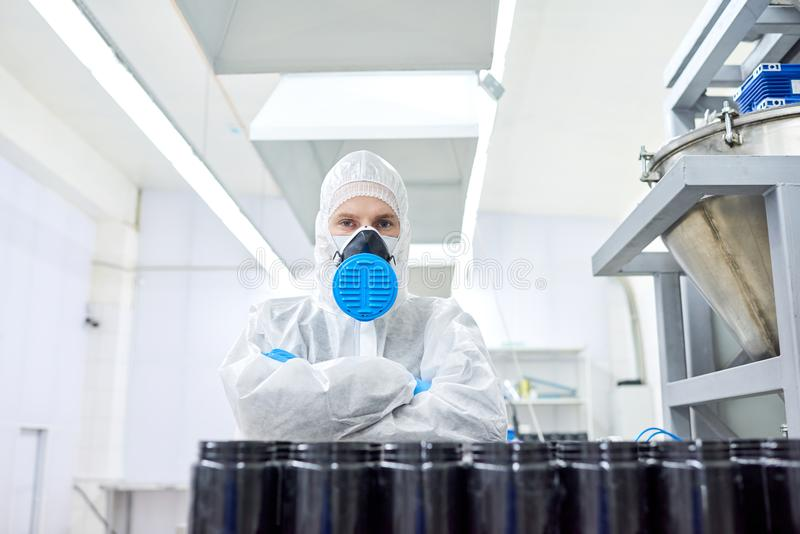 Confident Worker of Sport Nutrition Factory stock photo