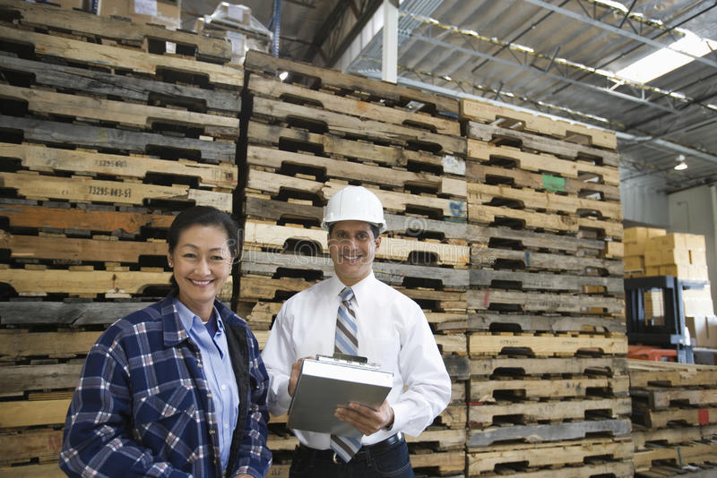 Confident Workers In Distribution Warehouse royalty free stock photo