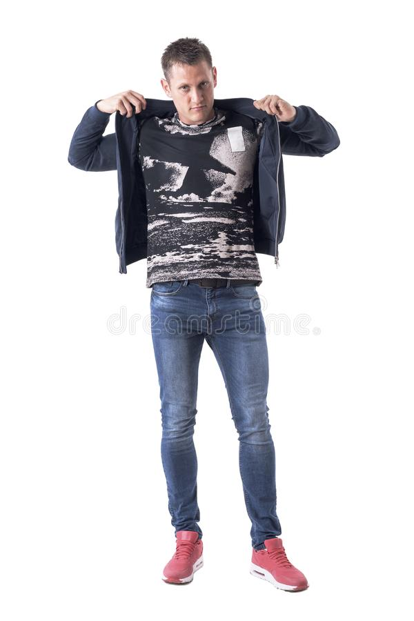 Confident young adult casual style man getting bomber jacket dressed up. Full body isolated on white background royalty free stock photo