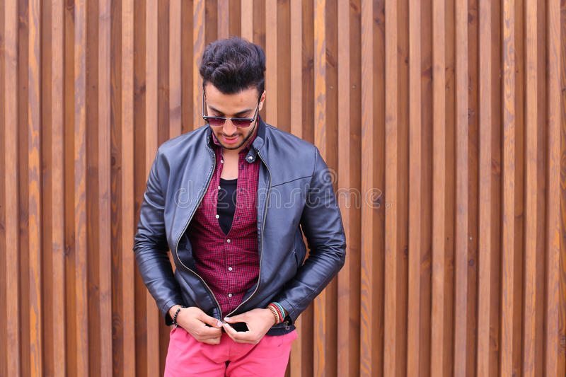 Attractive Young Adult Arabian Man Poses Into Camera, Corrects Hairstyle  And Smiles, Waits For Meeting And Advertises Male Sunglasses, Looks Around  Wearing ...