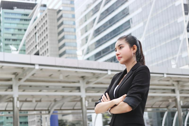 Confident young Asian business woman at outside office stock images