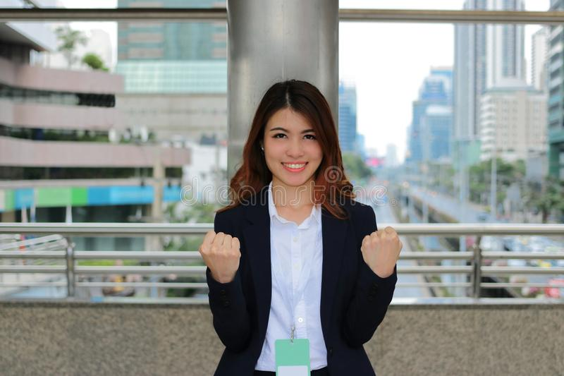 Confident young Asian businesswoman standing on blurred city background. Leader woman concept. Confident young Asian businesswoman standing on blurred city stock photos