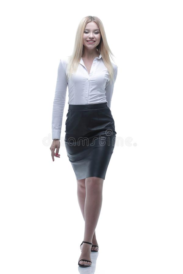 Portrait in full growth confident young business lady is coming forward. stock photography