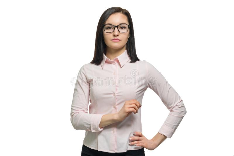 Confident young business woman in glasses pink shirt on white isolated background stock photography